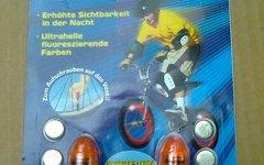 Tireflys UV LED-Ventilkappen-Set mit Blinkfunktion orange und Reflektoren Cateye